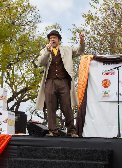 Eric Trueheart, Master of Ceremonies, warms up the crowd during the at the Last Grilled Cheese Invitational at the Los Angeles Center Studios on Saturday April 12, 2014.