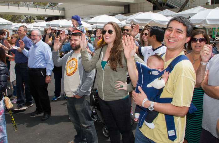 Ben Mui (far right) recites, along with the rest of the crowd, the Pledge to Cheese at the Last Grilled Cheese Invitational at the Los Angeles Center Studios on Saturday April 12, 2014.