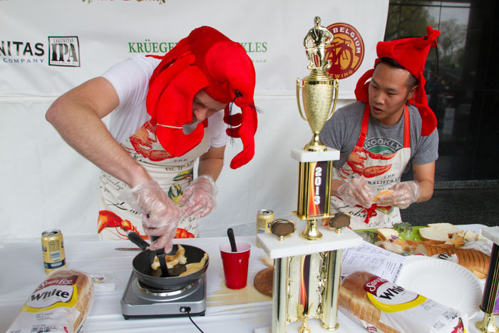Taylor Henderson (left) and Andrew Bui make their sandwich entitled 'Rock Lobster'  at the Last Grilled Cheese Invitational at the Los Angeles Center Studios on Saturday April 12, 2014.