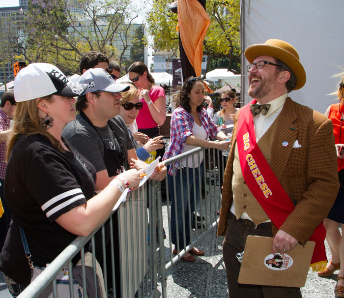 Montano Sokolow, The Mayor of Cheese, hands out Grilled Cheese Invitational stickers to the crowd at the Last Grilled Cheese Invitational at the Los Angeles Center Studios on Saturday April 12, 2014.
