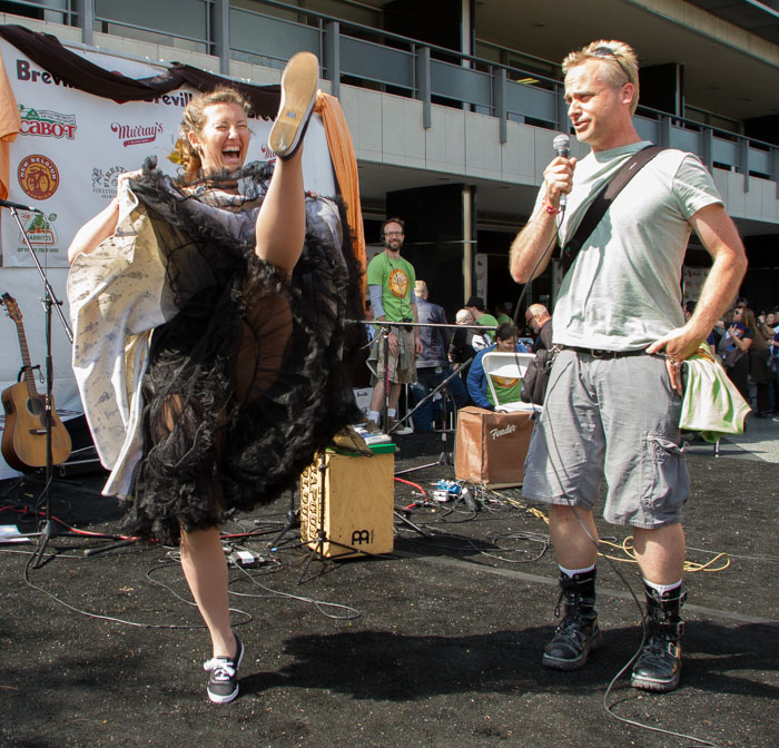 Vanessa River Yakobovich dances the Can-can while her fiancé Andy Feifarek sings to win a grilled cheese maker at the Last Grilled Cheese Invitational at the Los Angeles Center Studios on Saturday April 12, 2014.  (Benjamin Simpson)