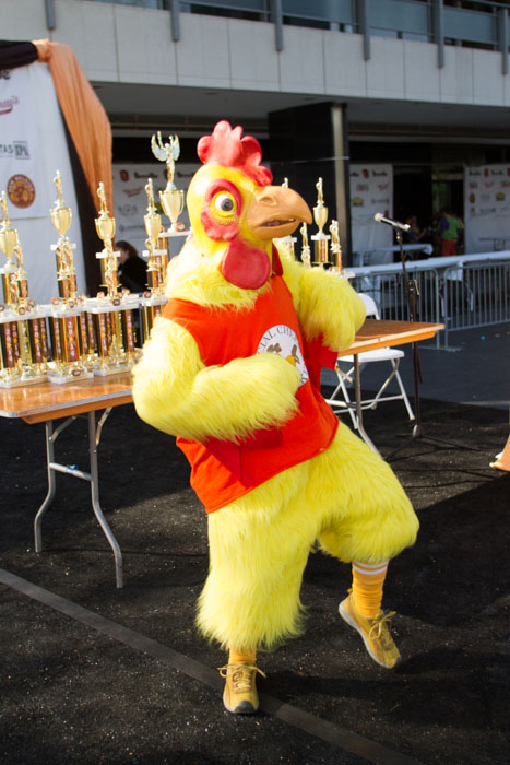 The Official Cheese Chicken dances on stage while the ballots are being counted at the Last Grilled Cheese Invitational at the Los Angeles Center Studios on Saturday April 12, 2014.