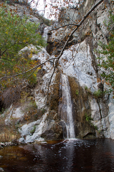 The top and middle waterfalls of Fish Canyon, just after the first rain storm of the season, with the water brown with run off.