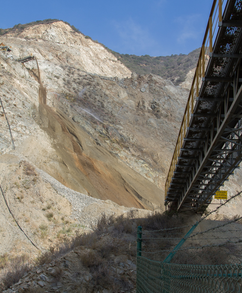 Aggregate is thrown down the side of the mountain as mining operations are viewed from the newly created hiking trail up Fish Canyon.